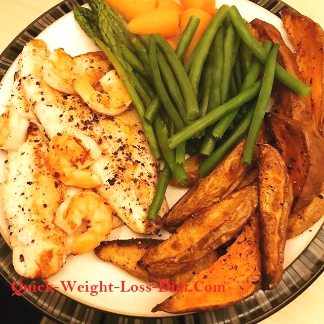 Sea_bass_with_king_prawns_sweet_potato_wedges