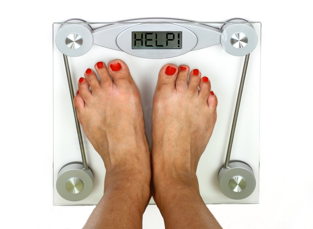 Woman_on_weighing_scales